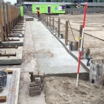 Gestorte betonnen vloer achter de CSM-wand
